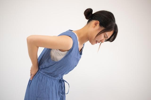 腰痛の女性。恵比寿コ・メディカル整体院の施術で解消